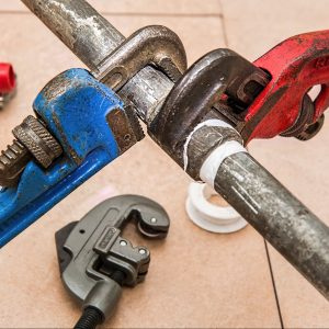 plumbing pipes with wrench